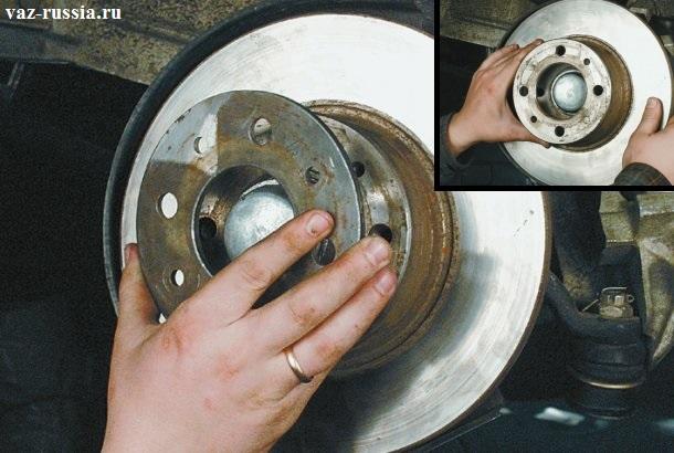 Снятие дистанционного кольца с самого диска, а так же снятие данного диска после снятия этого самого кольца