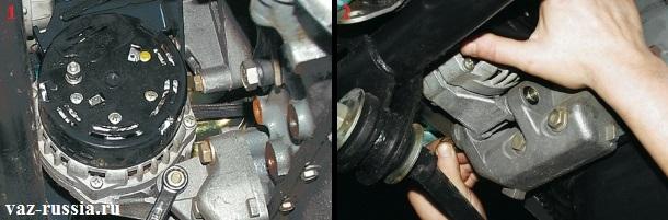 Выворачивание гайки нижнего болта крепления генератора и выбивание после чего самого болта из отверстия в генераторе