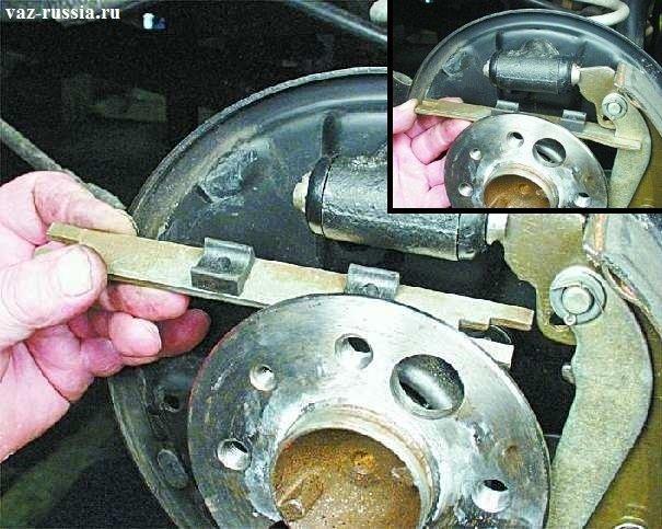 Рисунок заднего тормозного механизма и распорной планки ваз2107