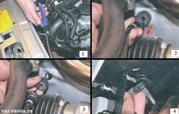 Разрезание одноразового пластмассового хомута при помощи бокорезов и вынимание резиновой оболочки с демпфером из отверстия в кузове